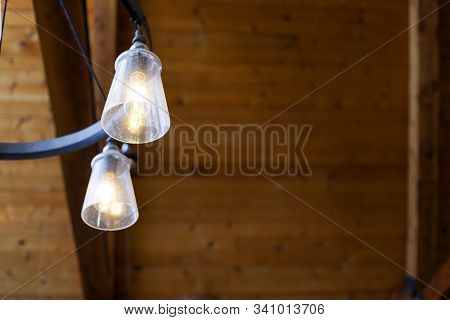Close Up Of Lighting Fixtures Hanging From A Wooden Ceiling