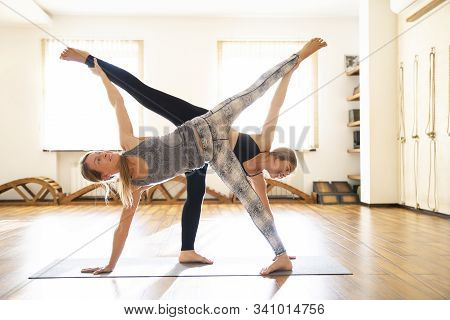 Yoga Class, Women Doing Standing Yoga Pose. Wellness And Healthy Lifestyle.