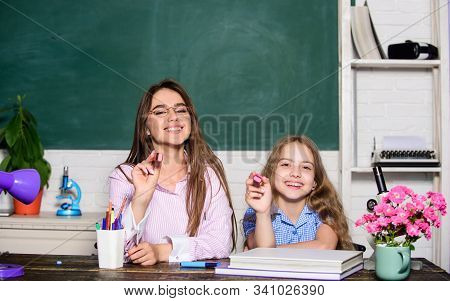 Play And Learn On September 1. Happy Small Child And Teacher Hold Markers On September 1. Little Pup