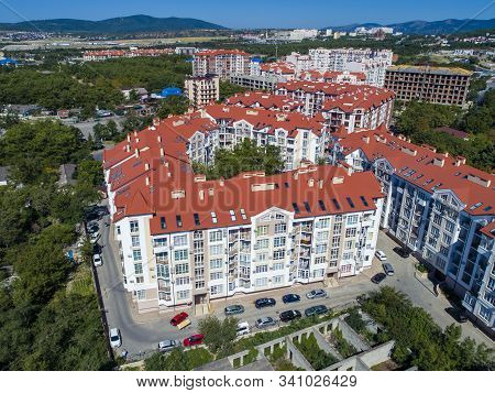 The Multi-storey Residential Micro District Consisting Of Several Buildings. Red Roof. The Residenti