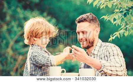Feeding Son Natural Foods. Stage Of Development. Feed Son Solids. Dad And Boy Eat And Feed Each Othe