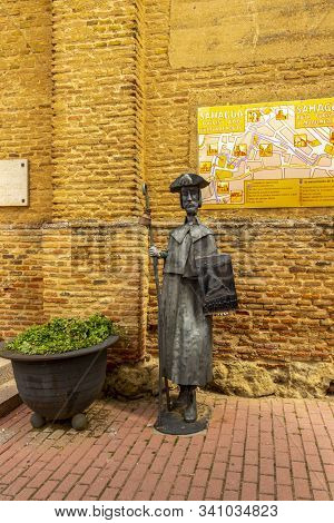 Sahagun, Spain - May 21, 2017: Monument Of A Pilgrim In Front Of The Ancient Church De La Santisima