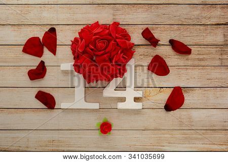 Wooden Background With Petals, Flowers And Wooden Numbers Of Dated 14 February. The Concept Of Valen