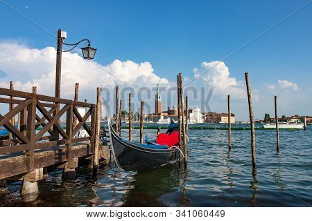 Docked Gondola By Grand Canal In Venice Italy