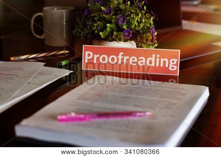 Proofreading English Card Over Blurred Text On Black Table
