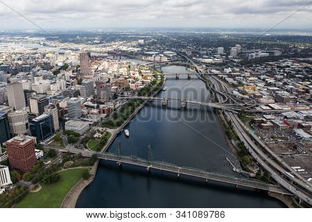 Aerial view of the Williamette River, bridges, buildings and streets in downtown Portland, Oregon, USA.