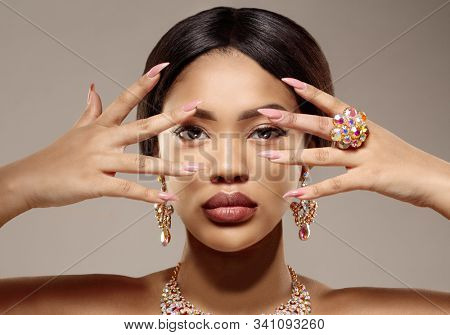 Beauty black skin woman African Ethnic female face. Luxury Young african american model with jewelry, earrings and ring