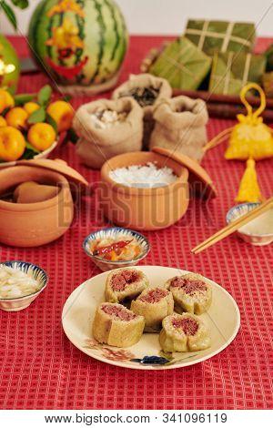 Cylindrical Steamed Cake Served On Table For Family Tet Celebration