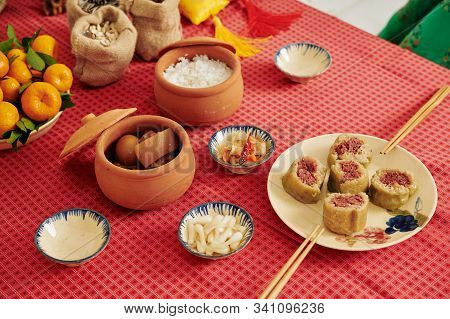 Served Ceramic Pots With Thit Heo Kho Trung - Vietnamese Caramelized Pork Belly With Hard-boiled Egg