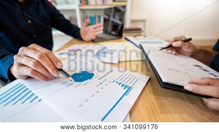 Business People Talking Discussing With Coworker Planning Analyzing Financial Document Data Charts A