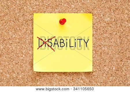 Turning The Word Disability Into Ability With Red Marker On Yellow Sticky Note Pinned With Red Push