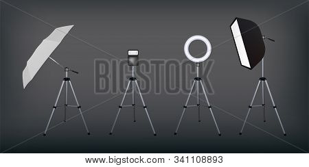 Soft Box And Umbrella Reflectors, Flash And Circular Speed Light. Dark Background. Photo Flash Equip