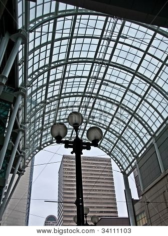 City Glass Archway With Street Lamp