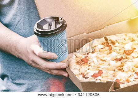 Man Is Holding Box With Tasty Pizza And Paper Cup With Drink, Close Up. Fast Food For Lunch. Snack O