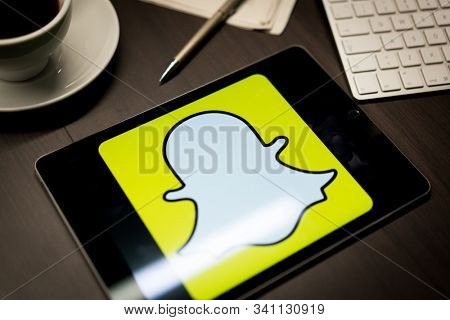 New York, New York / USA - 11 11 2019: Logo of Snapchat on the iPad Air2 in on office desk