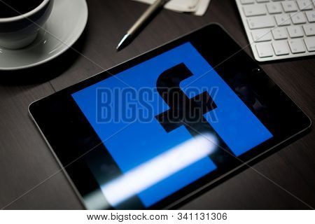 New York, New York / USA - 11 11 2019: Logo of Facebook on the iPad Air2 in on office desk