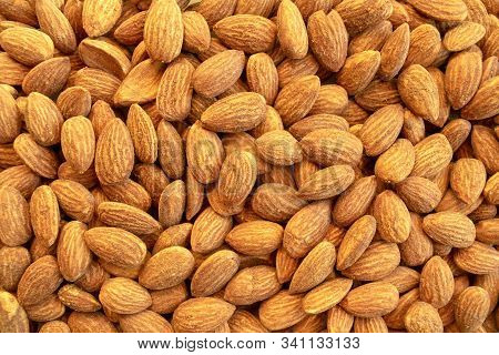 Background Of Almond Nuts. Healthy Snack And Food. Salted And Roasted Bbq Almonds. Top View.