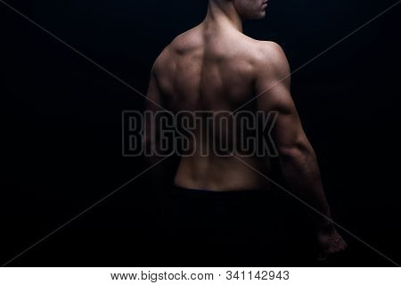 Partial View Of Sexy Bodybuilder With Muscular Back Isolated On Black