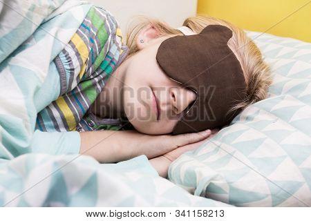 Little Girl Sleeping In Sleep Mask