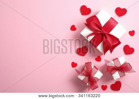 Happy Valentine's Day Card Mockup. White Gift Boxes With Red Ribbon Bow And Red Hearts On Pink Backg