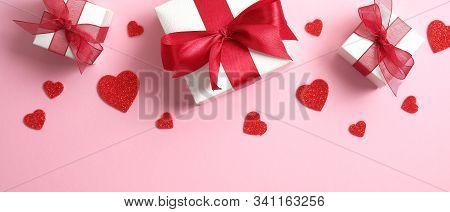Valentine's Day Background With White Gift Boxes Decorated Red Ribbon Bow And Red Hearts. Valentines