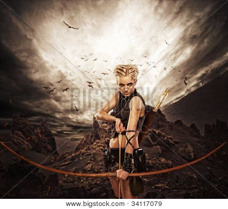 Woman archer against storm over rocks poster