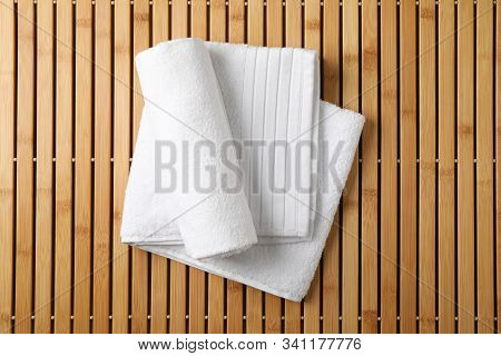 White Fresh Towels On Bamboo Background, Top View