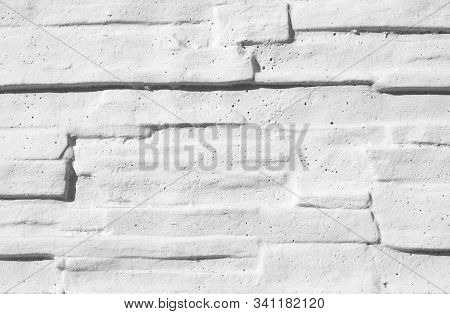 Texture Stained Blocks Of Stonework. Plastered Facade Of Building Of Modern Blocks Tiles. Grey Fence