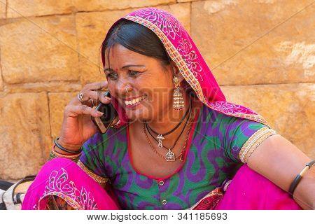 Jaisalmer, Rajasthan, India - October 13, 2019 : Rajasthani Woman Smiling While Talking In Mobile Ph