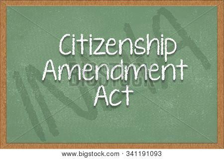 Citizenship Amendment Act Written On Green Black Board With India As A Background.