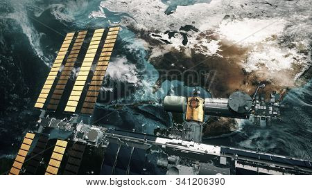 ISS with solar panel revolve over Earth atmosphere. International Space Station orbiting planet. Realistic America continent. 3d animation. Elements of this image furnished by NASA
