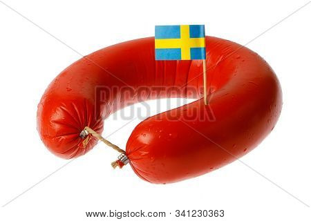 Swedish Traditional Falukorv Sausage With Attached Decorative Swedish Flag, Isolated On White Backgr