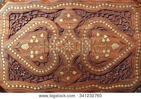 Beautiful Wooden Carved Table Top On The Indian Market With Floral Patterns And Metal Inlay In India