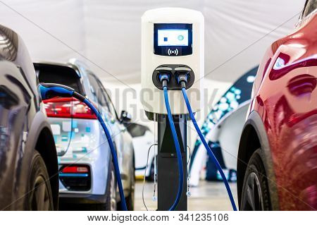 Modern Electrical Fast Charger To Electrical Or Hybrid Phev Automobiles. Future Energy Power. Ecolog