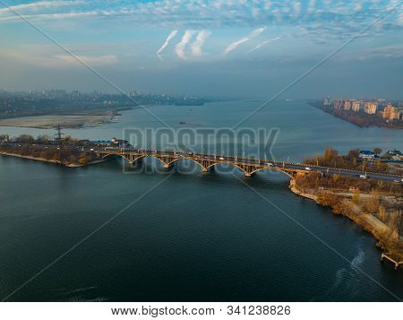 Aerial Autumn Voronezh Cityscape From Drone Flight Height. View Of The Vogresovsky Bridge Over Voron