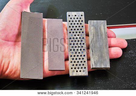 Ski Tuning Files And Stones In A Hand: Panzar (panzer) File, Mill File, Diamond Stone, Ceramic Stone