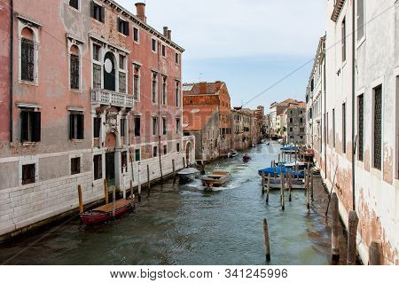 Wide Canal With Boat Traffic In Old Venice