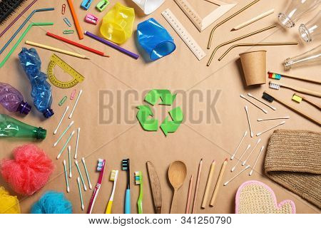 Recycling Symbol And Household Goods On Beige Background, Flat Lay