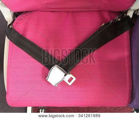 Black Safety Belt On Pink Airplane Seat