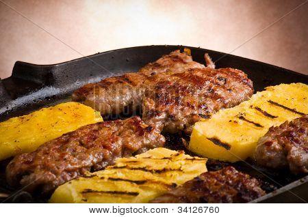 Sausage and sliced of polenta
