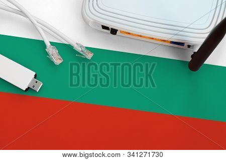Bulgaria Flag Depicted On Table With Internet Rj45 Cable, Wireless Usb Wifi Adapter And Router. Inte