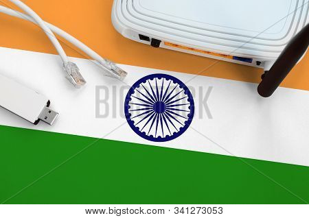 India Flag Depicted On Table With Internet Rj45 Cable, Wireless Usb Wifi Adapter And Router. Interne