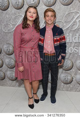 LOS ANGELES - DEC 07:  Mackenzie Hancsicsak and Parker Bates arrives for the Brooks Brothers Holiday Celebration Honoring St. Jude on December 07, 2019 in West Hollywood, CA