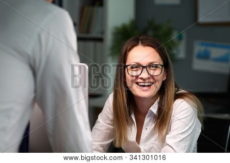 Portrait Of Happy Businesswoman Looking At Camera With Joyfulness. Businesslady In White Formalwear