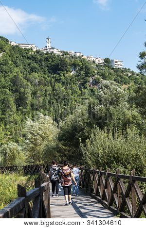 Posta Fibreno,frosinone,lazio,italy-august 22,2019:summer View Of Walking People On The Wooden Footp