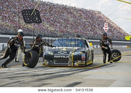 BROOKLYN, MI - JUN 17, 2012:  Ryan Newman (39) brings in his US Army Chevrolet for service during the Quicken Loans 400 at the Michigan International Speedway in Brooklyn, MI on June 17, 2012.
