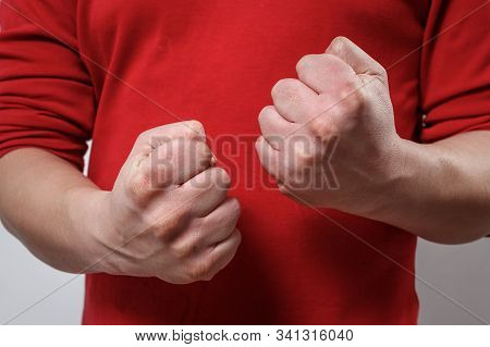 The Man's Clenched Fists
