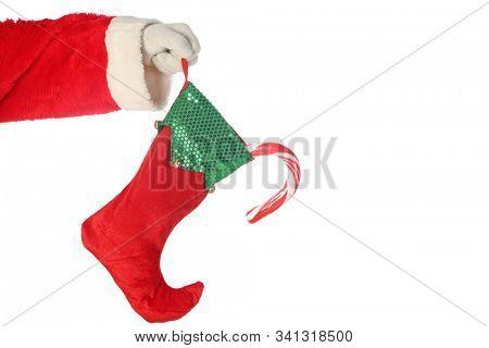 Santa Claus holds a Christmas Stocking.  Santa holds a Red and Green Christmas Stocking. Isolated on white. Room for text. Chris Kringle loves Christmas and the Holiday Season. Santa says Ho Ho Ho.
