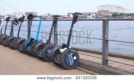 Copenhagen, Denmark - Jul 04th, 2015: Modern Electric Segway For Sightseeing Tour Parked Next To Riv