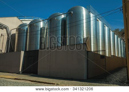 Bento Goncalves, Brazil - July 11, 2019. Stainless Steel Storage Tanks For Grape Juice Or Wine At Au